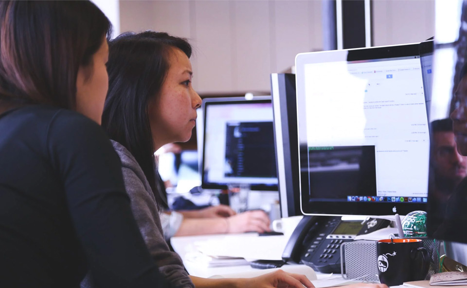 Two people at a computer